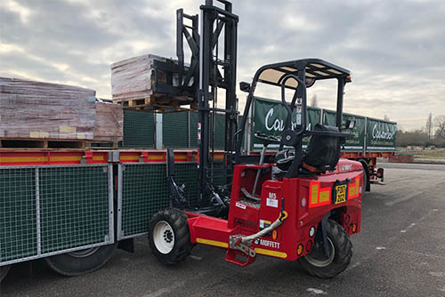 Forklift loading items onto a lorry