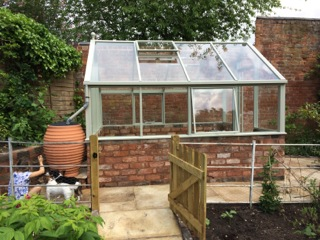 an image of a finished greenhouse from the side